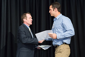 Aaron Drake receives his award from the dean of the College of Engineering Dr. David McLean.